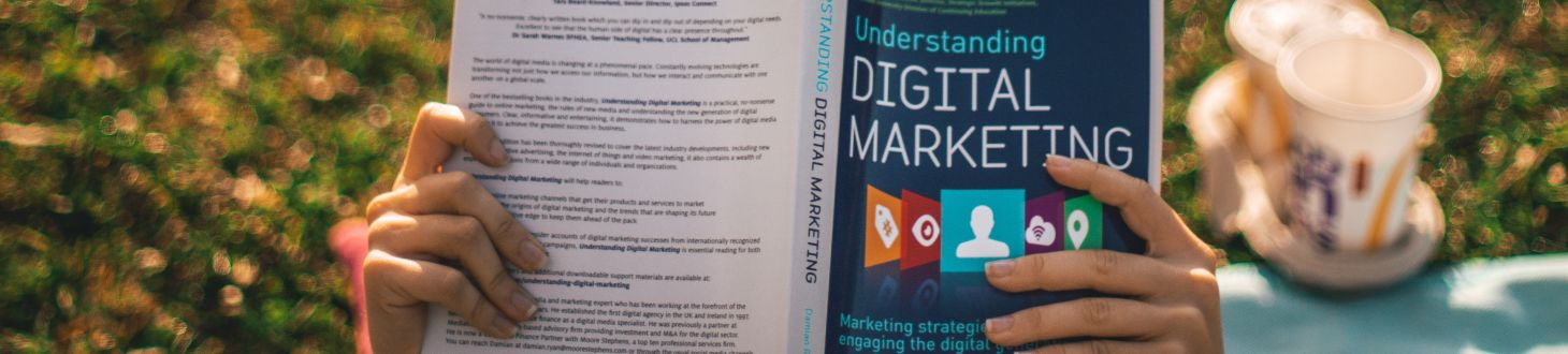 girl reading a book about digital marketing